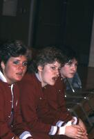Augsburg women's basketball team players on the bench watch the game, 1985.