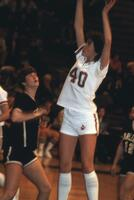 An Augsburg women's basketball team player takes a shot, 1984.