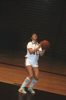 An Augsburg women's basketball team player goes up for a layup, 1984.