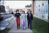 Augsburg women's track and field team runners in front of Si Melby Hall, 1984.