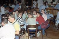 Augsburg women's softball players sitting at table, May 1987