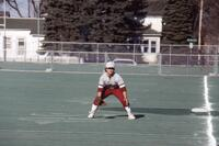 Augsburg women's softball outfielder bending knees, April 1988