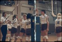 Augsburg women's volleyball players high-five each other, October 1987