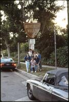 Augsburg women's softball players posing with Beverly Hills sign, May 1987