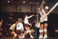 Augsburg women's volleyball player spikes ball, 1987