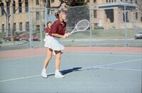 Augsburg women's tennis player holding racket upwards, April 1988