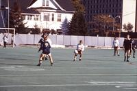 A ball mid-air heads toward Augsburg women's soccer player, October 1987