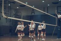 Augsburg women's volleyball players celebrate, October 1987