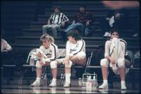 Augsburg women's volleyball players sitting on sidelines, 1987