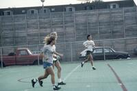 Augsburg women's soccer players running on field, October 1987