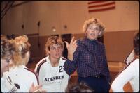 Augsburg women's volleyball coach talks with players, 1987