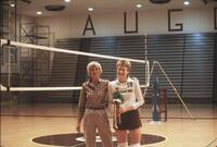 Augsburg women's volleyball player takes picture with her coach, 1987