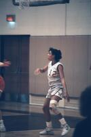 A rival player during a basketball game, February 1987