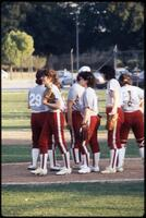Augsburg women's softball players standing together, May 1988