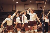 Augsburg women's volleyball teammates high five each other, 1987