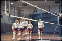 Augsburg women's volleyball players walk off court, October 1987