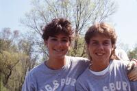 Augsburg women's softball players smiling for camera, April 1987