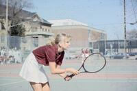 Augsburg women's tennis player hunched down, April 1988