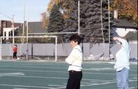 Augsburg women's soccer coach standing on sidelines, October 1987