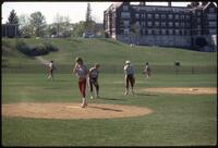 Augsburg women's softball team players practicing, April 1987
