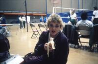 Augsburg women's volleyball player eating banana, November 1987