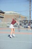 Augsburg women's tennis player prepares to hit incoming ball, April 1988