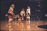 Augsburg women's volleyball player runs forward, 1987
