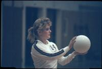 Augsburg women's volleyball player prepares to serve ball, October 1987