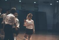 Augsburg women's volleyball players high five each other, 1987