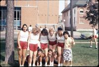 Augsburg women's track and field team runners taking a picture in Murphy Square, May 1987