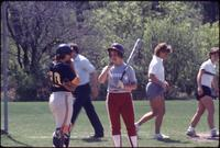 Augsburg women's softball player holding bat, April 1987