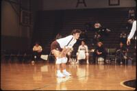 Augsburg women's volleyball player with hands on knees, 1987
