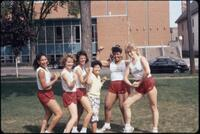 Augsburg women's track and field players flexing muscles, May 1987