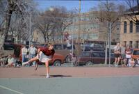Augsburg women's tennis with right leg in air, April 1988