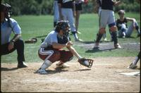 Augsburg women's softball catcher catching ball, May 1987