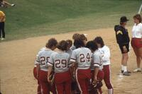 Augsburg women's softball players in a huddle, May 1988