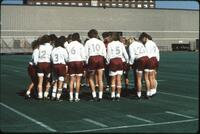 Augsburg women's soccer team players circle up to talk before a game, 1989.