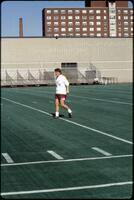 An Augsburg women's soccer team player before a game, 1989.