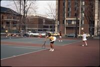 An Augsburg women's tennis team player plays in a match, 1989.