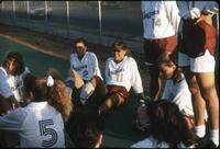 Augsburg women's soccer team players circle up and talk,1989.