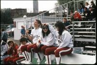 Augsburg women's softball team players on the bench, 1989.