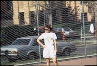 An Augsburg women's tennis team coach during a team practice, 1988.