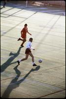 An Augsburg women's soccer team player dribbles forward, 1989.