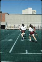 Augsburg women's soccer team players defend a rival, 1989.