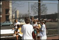 Augsburg women's tennis team players talk to their rivals, 1989.