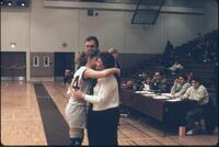 An Augsburg women's basketball team player hugs her parent, 1989.