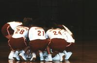 Augsburg women's volleyball team player huddle up before a match, 1989.