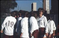 Augsburg women's soccer team players huddle up, 1989.