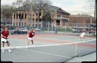 Augsburg women's tennis team players play doubles, 1989.