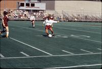 An Augsburg women's soccer team player passes the ball forward, 1989.